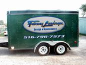 LANDSCAPING TRAILER WITH COMPANY LOGO