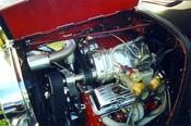 Twin Magnacharger Supercharger with side draft Dellorto carburetors -- Notice the 24 K gold plated velocity stacks.