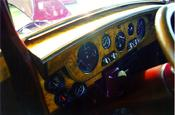 Rolls Royce burled wood dashboard & gauges -- Look close & you can see the RR in the large gauge.