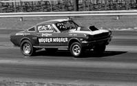 "The Hugger Mugger Mustang, racing at National Speedway in 1967.  Originally LETTERED by Gary, ""The Local Brush"""