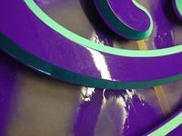 DETAIL shows the Metalflake glitter in the purple paint.