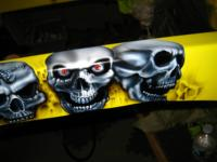 DETAIL- Skulls airbrushed on the 1932 Chevy chassis rails