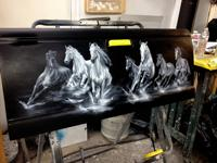 Horses airbrushed onto a pickup truck's tailgate.  Before Clear coating