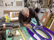 Gary hand painting the final details. of the sign in the town of Babylon, NY