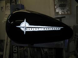 Gary, The Local Brush, Airbrushed the Harley Davidson emblem.  The faux chrome looks amazingly real.