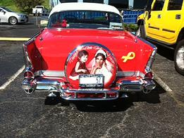 COMPLETED PORTRAITS on the back of a 1957 Chevrolet