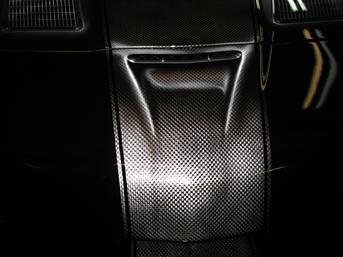 Carbon Fiber Racing Stripe is PAINTED on the hood of a Corvette