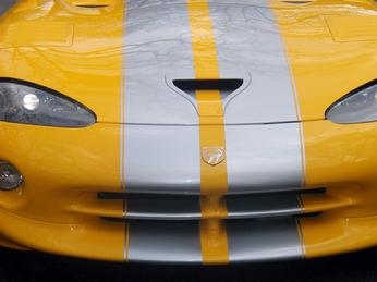 SILVER STRIPES PAINTED ON A YELLOW DODGE VIPER
