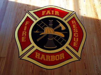 Fair Harbor Fire Dept. Logo, hand  painted on the floor of the new building.