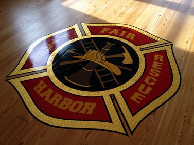 Gary the Local Brush hand painted the Maltese Cross using 23K Gold Leaf on the Fair Harbor Fire Dept. meeting room floor