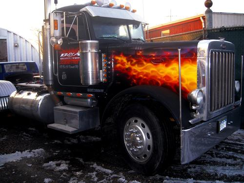 CHROMED  AIRBRUSH  LETTERING  on doors & Airbrushed Real Fire on the hood of this 18 wheeler....This truck is real hot!