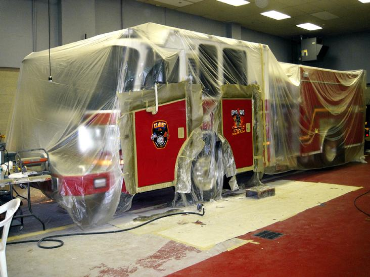 Elmont Engine 1 - masked & completely covered in plastic during the AIRBRUSHING procedure.